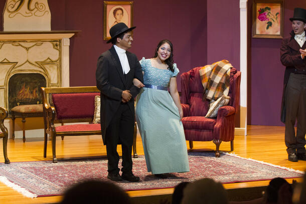 Two students stand, arms intertwined, and bow as they finish up their play