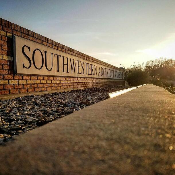 """Outside sits a short, but long brick sign that reads """" Southwestern Adventist University"""""""