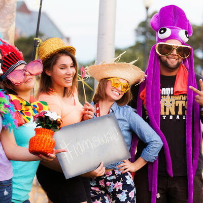 At the back-to-school bash, five students wear silly hats, glasses and other props for a picture