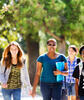 Five students walk to talk to each other as they leave class